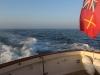 The Guernsey ensign enjoys the morning sun