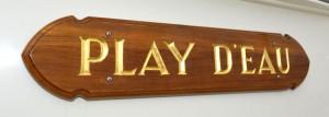 Play d'eau's name board in gold leaf on teak